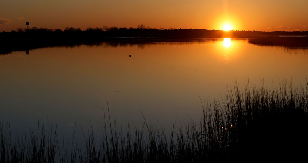 The sun rises over the Pamunkey River near West Point, Virginia Wednesday morning March 4, 2020.